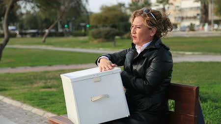 sacked : Fired business woman with a box of her belongings and being stressed or worried
