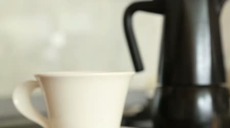 caffe : Classic italian coffee maker, moka pot retro with coffee beans and mug Stock Footage