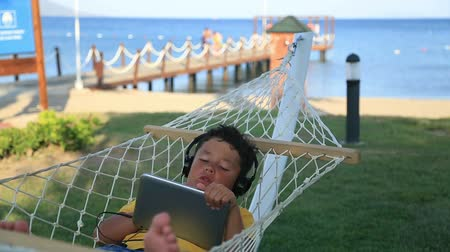 curto : Child  with earphone listening to music with digital tablet