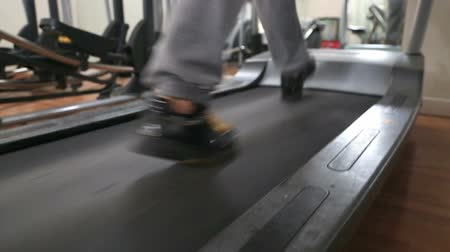 nadváha : Woman Walking And Running On Treadmill