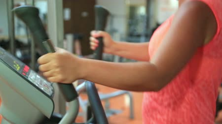 overweight : Woman trains on stepper machine in gym. Concept of health and fitness. Stock Footage