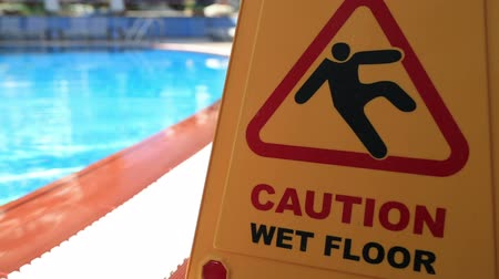 prominent : Sign showing warning of caution wet floor