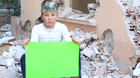 orphans : Portrait Of A Frightened Little Boy Holding Onto A Green Screen Poverty And Hunger Concept