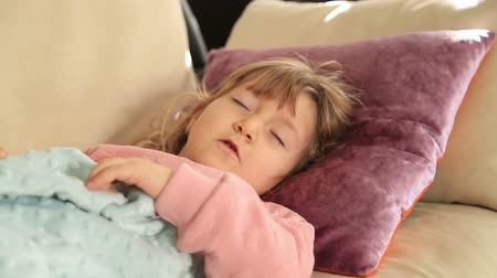napping : Little cute girl sleeping on sofa Stock Footage