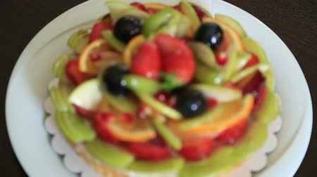 flan : Fresh dessert fruit tart covered in assorted  fruits