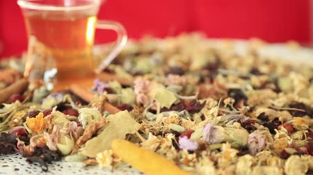 сухой : Overhead view of various sorts of tea. Flavoured with Assorted Herbs with a teacup