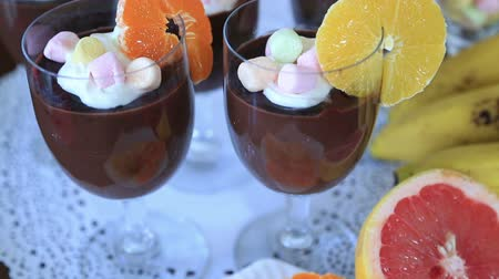 garnishing : Delicious chocolate mousse with different kind of fresh fruits and candy