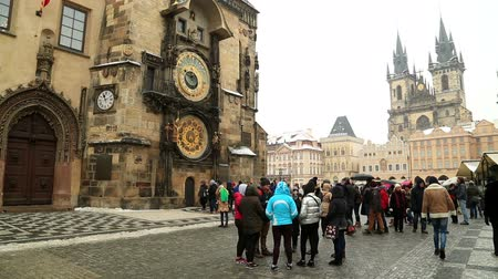 europe population : Tourists visiting medieval astronomical clock in the Old Town square in Prague  at winter time CZECH REPUBLIC - February  07, 2017 Stock Footage