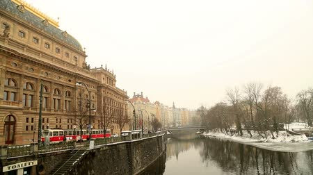 crossway : A view of the Legion Bridge and buildings along the Vltava river at winter time