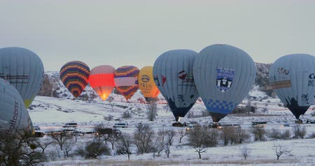 travertine : Hot air balloons flying over famous city Cappadocia at winter time. Goreme Nevaehir Turkey 28 Jan 2018 Stock Footage