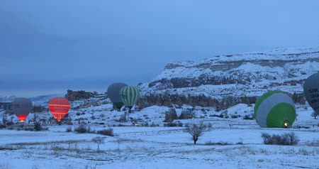 travertino : Hot air balloons flying over famous city Cappadocia at winter time. Goreme Nevaehir Turkey 28 Jan 2018 Vídeos