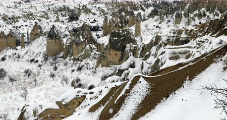 vacations cones : Valley of love covered by snow at winter time Cappadocia. Turkey Stock Footage