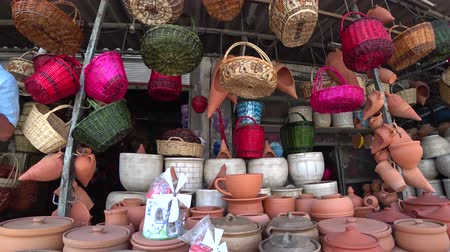 bamboo basket : Wicker basketsand ceramic pots in a street market