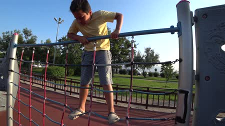 školák : Portrait of a happy young boy having fun at the playground