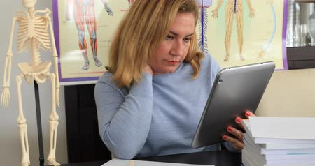 ilerici : Female doctor  working with digital tablet at the office