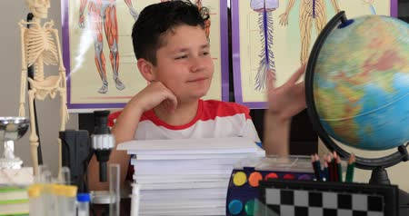 keşfetmek : Portrait of a caucasian smart  schoolchild with many kind of school supplies looking at the camera and smiling