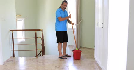swabber : Man with mop cleaning floor at home Stock Footage