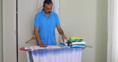 ütüleme : Middle Aged  Man Ironing Clothes With Electric Iron