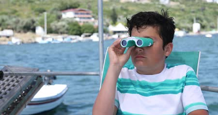 denizciler : Portrait of a teenager traveler with binucular looking around on yacht deck at summer vacation