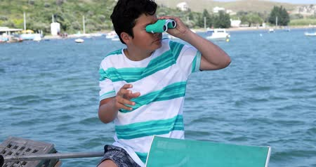 binocular : Portrait of a teenager traveler with binucular looking around on yacht deck at summer vacation