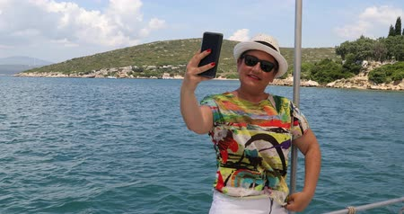 marine technology : Portrait of a female tourist people in yacht deck making selfie on smartphone at summer vacation Stock Footage