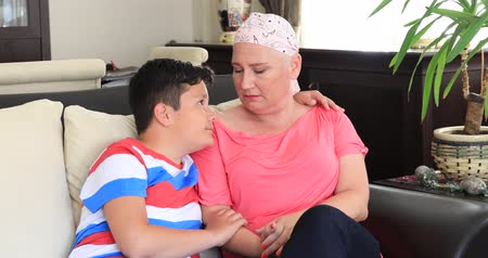 preocupações : Young boy gives support his sick mother Stock Footage