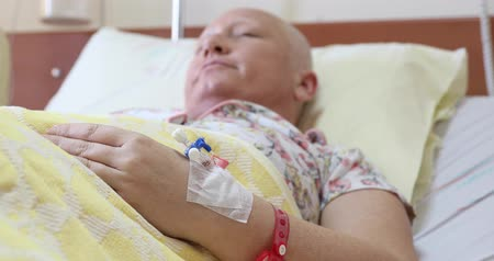 malignancy : Cancer patient lying in hospital bed