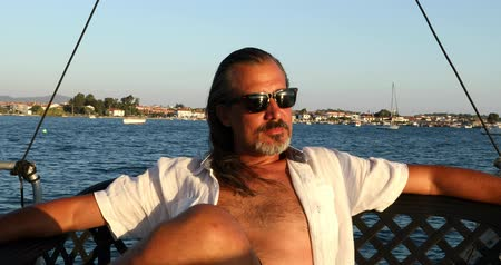one man only : Portrait of a middle aged  burunette man on luxury yacht resting at summer holiday