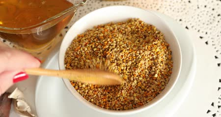 nutritional supplement : Bowl full of bee pollen with honey Stock Footage