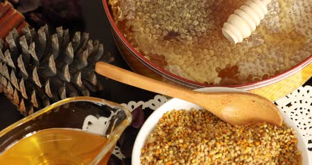 nutritional supplement : Bowl full of bee pollen with honey comb