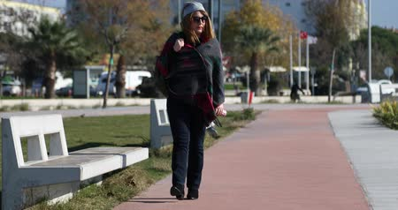 breathing fresh air : Woman walking in the city park