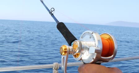 Spinning rod in front of deep sea water