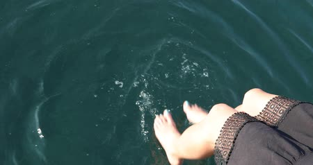 bronzlaşmış : A view of  beautiful sexy womens feet on the yacht at summer time