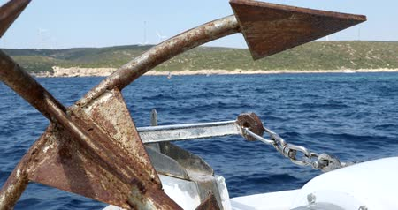 zkorodované : Boat with old anchor  cruising on the Mediterranean sea