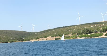 tvořit : Clean energy powerplant Wind turbines farm and Mediterranean sea coast