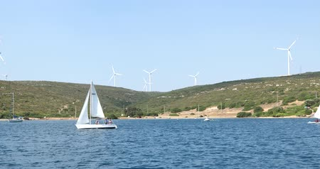 powerplant : Clean energy powerplant Wind turbines farm and Mediterranean sea coast and Beautiful sailboat sailing