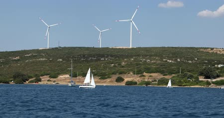 powerplant : Clean energy powerplant Wind turbines farm and Mediterranean sea coast with beautiful white sailboat