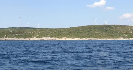 sustainable resources : Clean energy powerplant Wind turbines farm and Mediterranean sea coast