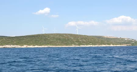 anidride carbonica : Clean energy powerplant Wind turbines farm and Mediterranean sea coast