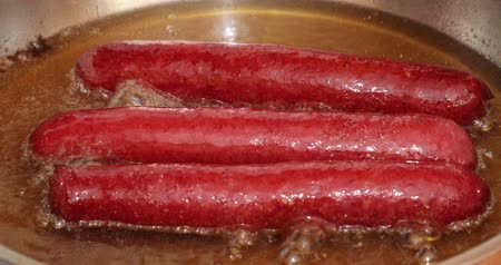frypan : Delicious sausages frying in a pan