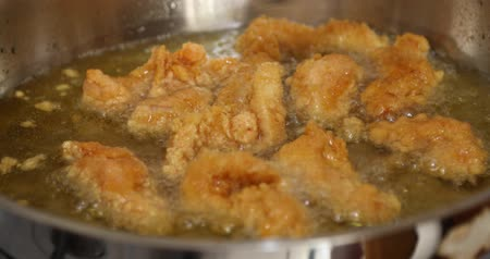 chicken recipes : Golden color chicken wings cooking into a wok Stock Footage