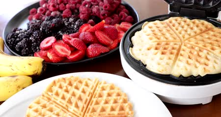 holiday makers : Making Homemade Delicious Waffles In An Electric Waffle Maker