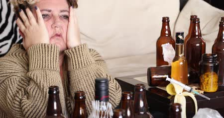 addiktív : Middle aged miserable woman in depression, drinking alcohol Stock mozgókép