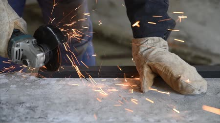 locksmith : Cutt metal profile using electric angle grinder, specialist at work