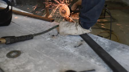 locksmith : Specialist cutting rectangular metal profile using the electric angle grinder, skills and competence, sparks fly around, process closeup Stock Footage