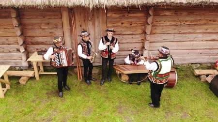 költő : Nahuievychi village, Lviv, Ukraine - August 26, 2018: Men in Ukrainian national dress play musical instruments. Celebrating the anniversary of the birthday of the prominent Ukrainian poet Ivan Franko