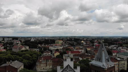 drohobych : Aerial view of ancient city Drohobych, center of saltmaking in Ukraine. Above ancient Church of St. Bartholomew in gothic and baroque Stock Footage