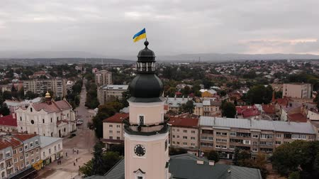 drohobych : Tower of City Hall of Drohobych city with flag of Ukraine. Flight around the tower with a landscape on the city, overcast, autumn