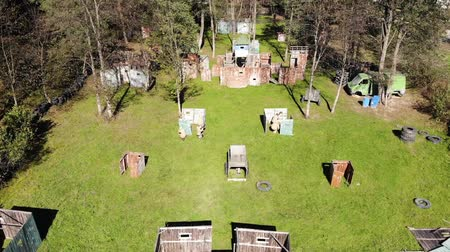 paintball : Aerial view of paintball game. Beginning of the round, players take positions on fire line Stock Footage
