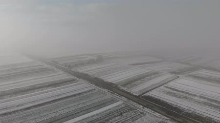 headstone : Aerial view of fields are covered with snow and old cemetery near the road. Winter came. Stock Footage